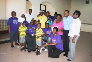 Some of the course participants and officials of the St. Kitts Nevis Association of Persons with Disabilities pose for a group picture. Course facilitator Ms Lisa Hickson is standing on the right.
