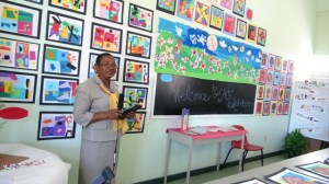 Elizabeth Pemberton Primary School Principal Marion Lescott stands before a section of drawings created by the students on display at an Art exhibition at the Elizabeth Pemberton Primary School on March 07, 2014