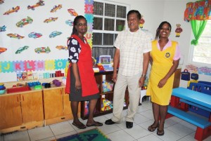 Ms Zanya Wilkinson (right) at her place of work, Steppin' Stone Nursery Phase One, with PEP Field Officer Mr Floris Finley and her supervisor Mrs Oneka Fortune-Pollard.