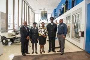 Inspector Roberts (2nd left), consultant A.D. Walwyn and Commissioner Walwyn (2nd right) with members of Houston Police Department