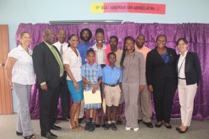 Ms. Sonia Boddie flanked by scholarship recipients and their parents and representatives of organizations who would have assisted her.    Left to right, Mrs. Sarah Percival British Honorary Consul, Dr.the Hon.Timothy Harris,Mr. Stanley Knight, Education Officer   Middle : Ms. Boddie, awardees and parents.   Right to left: Ms. Vera Lai, 2nd Secretary in the Embassy of the Republic of China on Taiwan, Ms. Chereca Weaver, Senior Youth Officer, Mr. Kevin Edwards, Corporate Communications and Marketing Manager at Lime