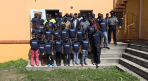 Premier of Nevis Hon. Vance Amory, along with the trainers and participants in the St. Kitts and Nevis Fire and Rescue Services Summer Safety Programme, at the Cotton Ground Community Centre on July 16, 2014