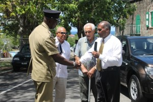 (extreme right) Premier of Nevis and Security Minister Hon. Vance Amory hands over the keys of a new Suzuki Grand Vitara to (extreme left) Assistant Commissioner of Police Robert Liburd at Bath Hotel, Bath Plain on September 18, 2014, while (middle l-r) Director of the TDC Group of Companies Michael Morton and donor and local businessman Charles Brisbane look on