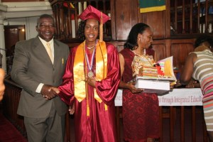 (L-R) Principal of the Nevis Sixth Form College and the Charlestown Secondary School Edson Elliott, Valedictorian of the 2014 graduating class of the College Chloe Williams and her mother Janet Parris at the Graduation ceremony at the Charlestown Methodist Church on November 12, 2014