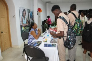 Students interacting with university representatives at the Nevis Public Library's 8th annual International College Fair on November 17, 2014, at the St. Paul's Anglican Parish Hall