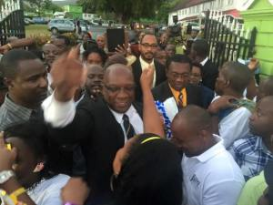 Dr Harris greeted by hundreds of supporters outside Government House