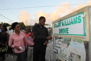 Stuart Williams' son, Saeed Williams unveils the road sign bearing his father's name Stuart Williams Drive on February 03, 2015