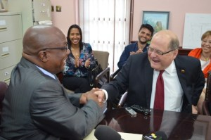 PM Harris and Ambassador Herrera shake on agreement