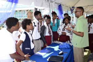 Students of the Verchilds High School gathers at one of the booths to learn more about the products and services offered