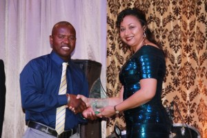 Wincent Perkins owner of Islander Watersports receives the Outstanding Allied Services Company Award from Mrs. Sharon Brantley, wife of the Minister of Tourism Hon. Mark Brantley, on behalf of the Ministry of Tourism at the Tourism Awards Gala and Dance at the Four Seasons Resort on May 28, 2016