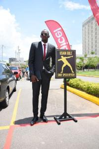 Usain Bolt, Digicel's Chief Speed Officer (CSO) checks out his designated parking slot on his first day at work at the Digicel regional HQ