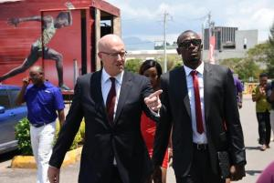 David Butler, Digicel Jamaica CEO, welcomes Usain Bolt, Digicel CSO to work on his first day