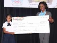 Devshi Saxena receives winning cheque from Courts St. Kitts and Nevis