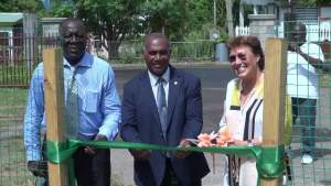 Premier of Nevis and Minister of Education Hon. Vance Amory cuts the ribbon to the new shade house donated by the Government and people of New Zealand with (left) Augustine Merchant, Coordinator of the Inter-American Institute for Cooperation on Agriculture in St. Kitts and Nevis and (right) New Zealand's High Commissioner to St. Kitts and Nevis Her Excellency Jan Henderson