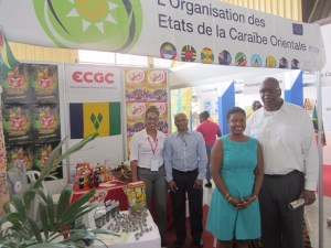 Saint Vincent and the Grenadines Ambassador to Cuba His Excellency Ellsworth I.A. John (right) and Minister Counsellor Mrs. Charmane Tappin-John (second from right), meet with representatives from the East Caribbean Group of Companies and other exhibiting firms.