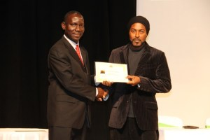 Photographer Sylvester Meade, the first winner of the Ministry of Tourism's Amateur Photographer of the Year contest accepting the winner's certificate from John Hanley, Assistant Secretary in the Ministry of Tourism at the awards ceremony in 2016 (file photo