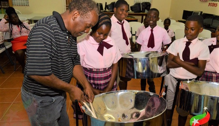 Mr williams instructing students at the seventh day adventist primary school.jpg 2