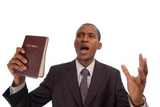 "this is an image of man holding a bible. this image can be used to represent ""sermon"" ""preaching"" etc..."