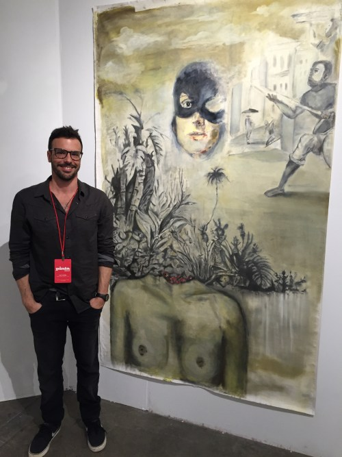 Daniel Athie and his painting