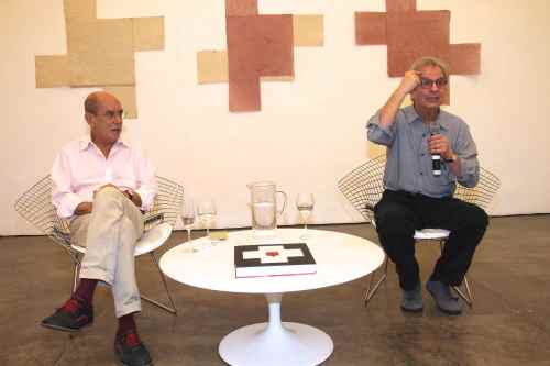 Brazilian Artist Antonio Dias and art critic Paulo Sergio Duarte at opening of Dias' solo show in Galeria Nara Roesler, São Paulo/Photo: Denise Andrade