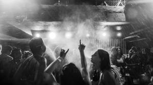 black and white shot of an indoor party