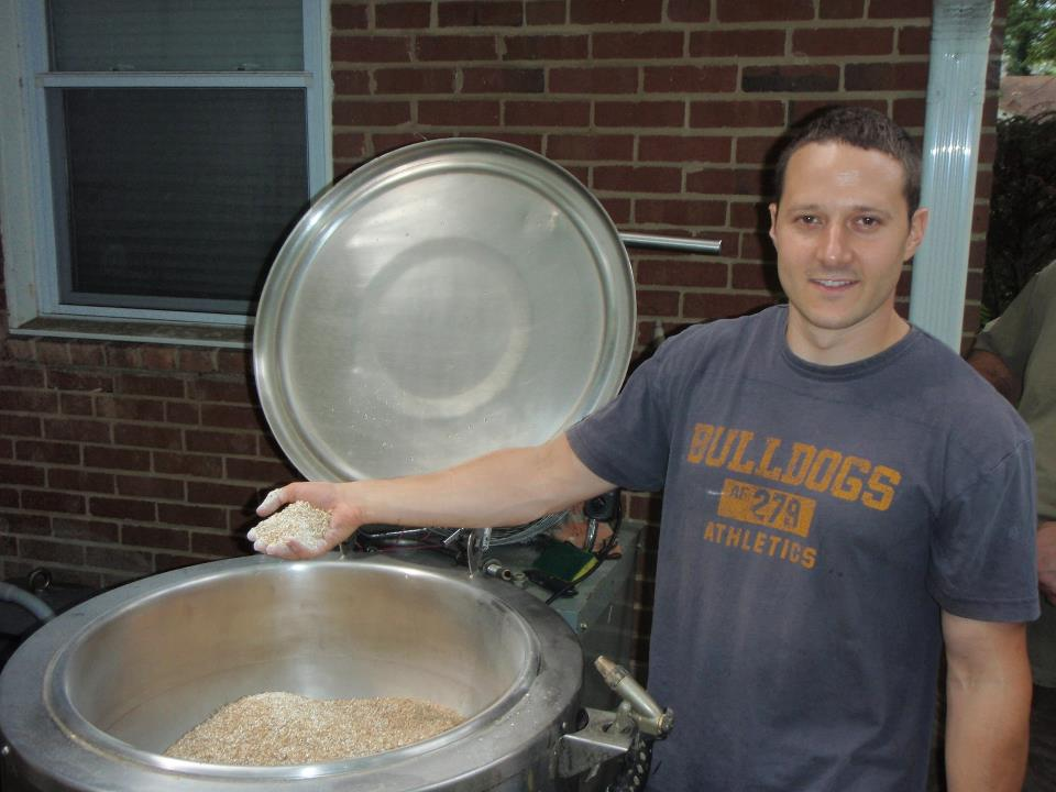 Mike showing off the brew kettle in his backyard in 2011.