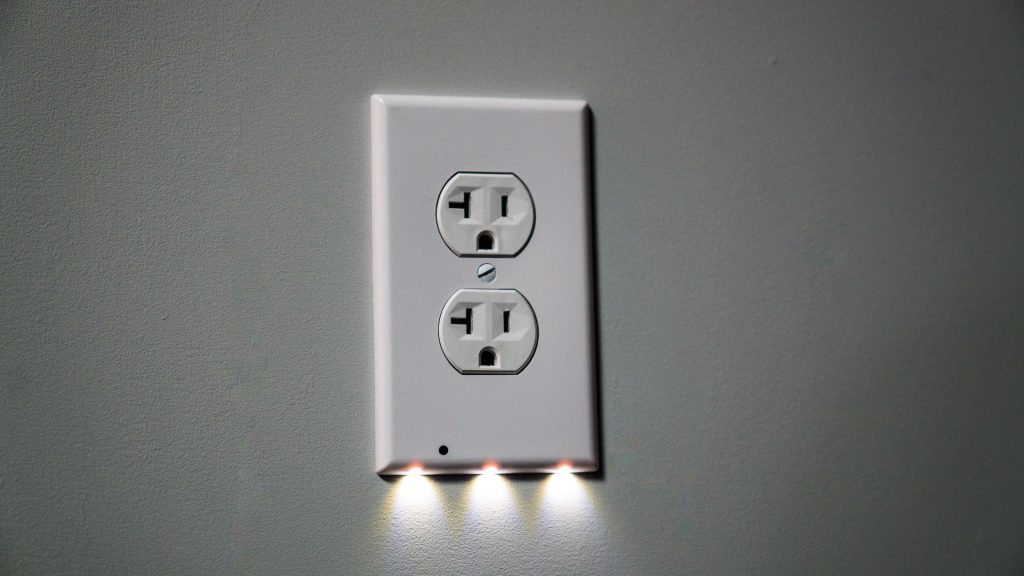 Outlet covers packing extra tech make for simple home improvement led outlet covers like snappower use a light sensor to activate the leds when it is sciox Gallery