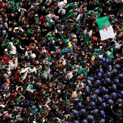 22 March 2019: Police officers attempt to disperse demonstrators trying to force their way to the presidential palace in Algiers during a protest calling for Abdelaziz Bouteflika to quit. (Photograph by Reuters/Zohra Bensemra)
