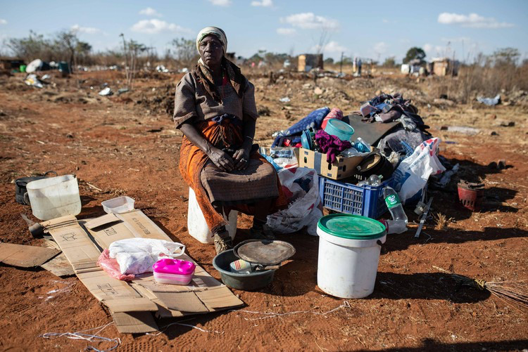 Ana Mnisi sits with all her worldly belongings after her shack in Esselen Park was demolished.