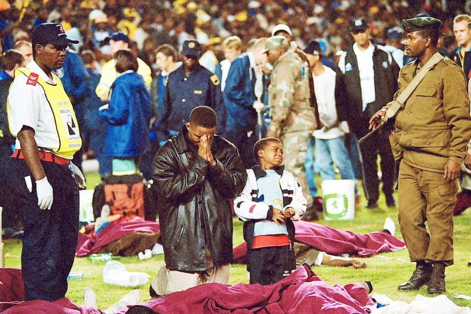 11 April 2001: South African rescue services work around the victims of a stampede at Ellis Park Stadium in Joburg in which 43 people died. Kaizer Chiefs were playing Orlando Pirates in the overfull stadium. (Photograph by Gallo Images/City Press/Mpho Mph