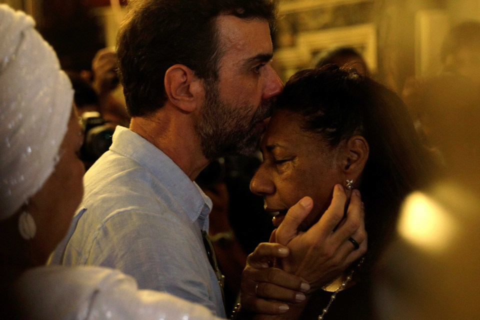 14 March 2019: Marinete da Silva - activist Marielle Franco's mother - is greeted by congressman Marcelo Freixo during a mass in Rio de Janeiro Brazil to mark the first anniversary of Franco's murder. (Photograph by Reuters/Ricardo Moraes)