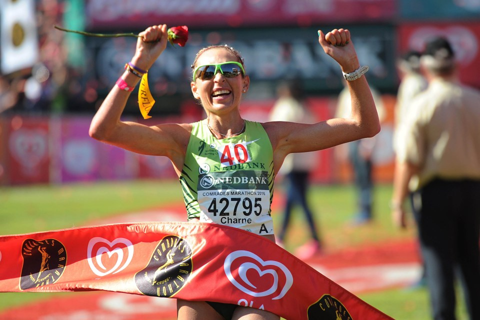 29 May 2016: Charne Bosman, of Murray and Roberts, in the colours of her former team Nedbank Running Club, celebrates winning the Comrades Marathon in Durban. (Photograph by Ian Carbutt)