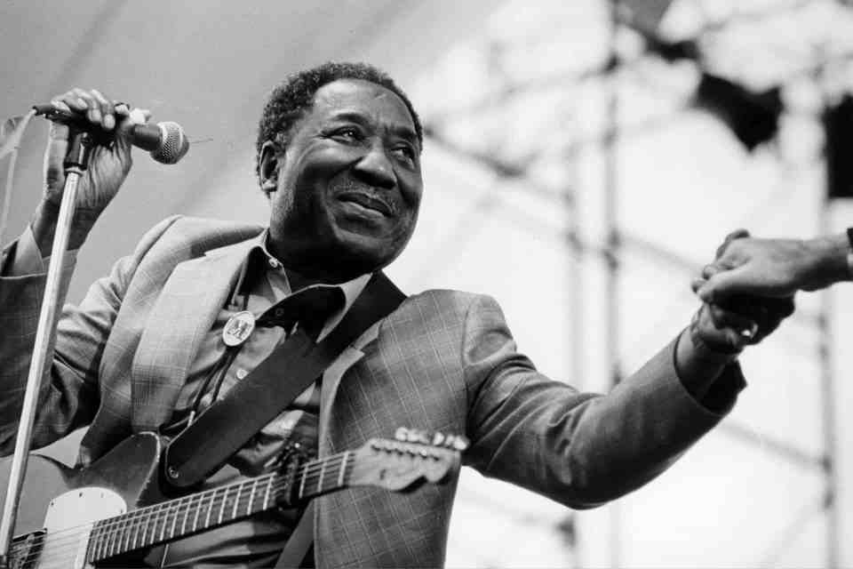 Circa 1970: American blues musician and singer Muddy Waters in concert. (Photograph by Val Wilmer/Redferns/Getty Images)