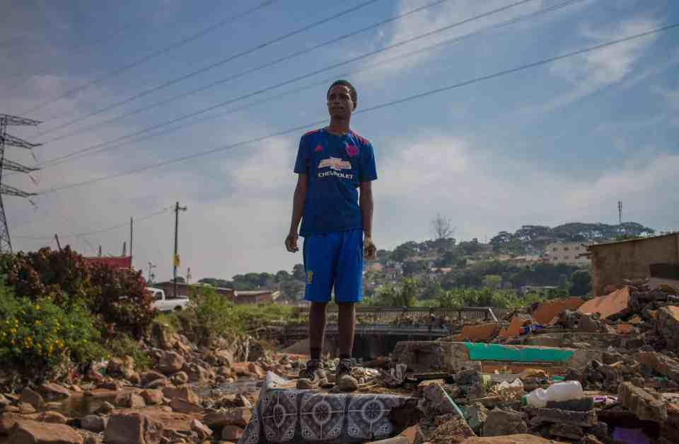 8 May 2019: Thabani Mthembu surveying the damage the floods in KwaZulu-Natal caused. He was using some of the rubble to rebuild his house.