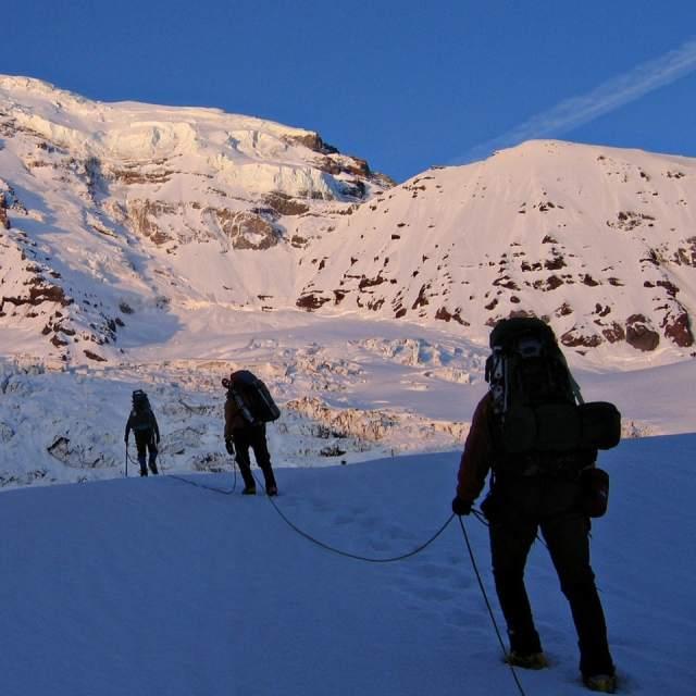 Roped climbing team on a Mount Rainier glacier.