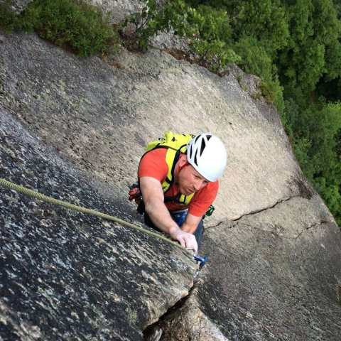Advanced rock climbing guiding and instruction on the upper pitch of The Prow on Cathedral Ledge, New Hampshire.