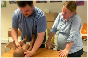 Photo of Team work, changing a baby with New Life Classes