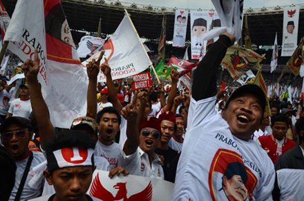 Indonesians show their support for Prabowo at a Jakarta rally. Could  their vote for him be their last? Photo by AFP.