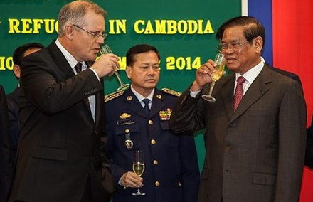 """Australian Minister of Immigration and Border Protection, Scott Morrison (L) and Cambodian Minister of the Interior and Deputy Prime Minister, HE Sar Kheng (R), toast the signing of the """"Memorandum of Understanding"""" relating to the resettlement of refugees."""