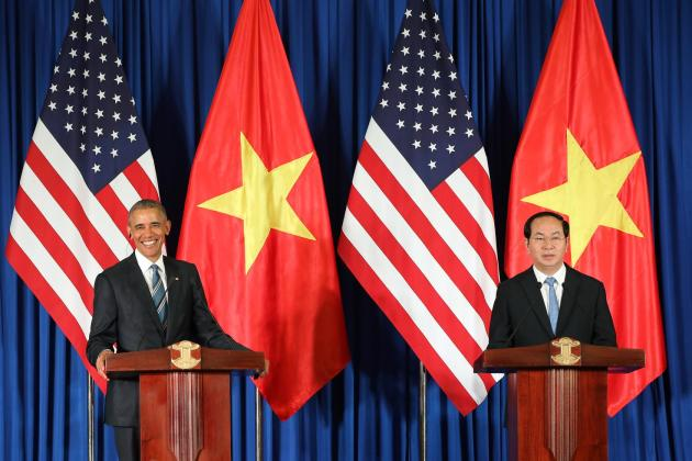 Vietnam's President Tran Dai Quang, right, and US President Barack Obama attend a press conference in Hanoi, Vietnam, Monday, May 23, 2016. Obama on Monday lifted a decades-old arms export embargo for Vietnam during his first visit to the communist country, looking to bolster a government seen as a crucial, though flawed partner even as he pushes for better human rights from the one-party state. (Luong Thai Linh, Pool Photo via AP)