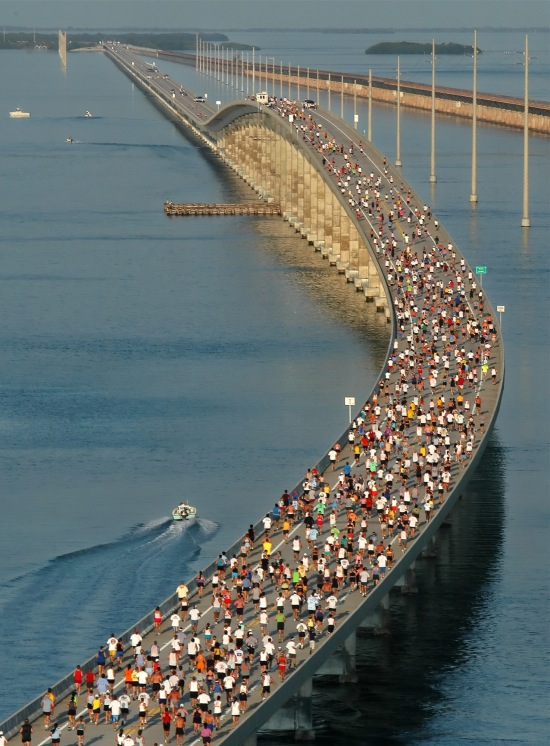 In this photo, provided by the Florida Keys News Bureau, racers approach the top of the Seven Mile Bridge near Marathon, Fla., during the Seven Mile Bridge Run. The event, across the longest of 43 bridges that help comprise the Overseas Highway in the Florida Keys, attracted 1,500 competitors. The 30th annual Seven Mile Bridge Run will be held Saturday, April 9.