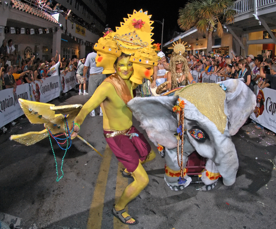 """Costumed revelers, themed as """"The Lotus People"""" march down Duval Street during the Fantasy Fest Parade in Key West, Fla. The 2010 parade is set to culminate Key West's annual Fantasy Fest costuming and masking festival on Saturday, Oct. 30, 2010."""