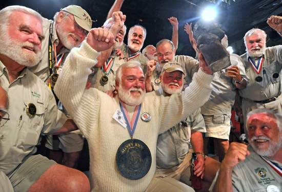 """David Douglas, center, celebrates at Sloppy Joe's Bar in Key West, Fla., after winning the 2009 """"Papa"""" Hemingway Look-Alike contest. Hemingway Days 2010 festival kicks off Tuesday, July 20, and ends Sunday, July 25, honoring author Ernest Hemingway who lived in Key West in the 1930s."""