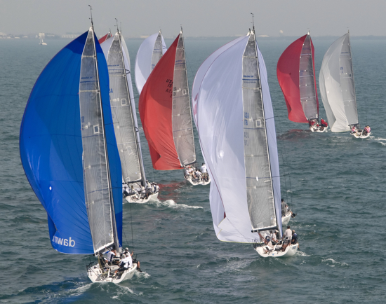 This photo taken by our very own Andy Newman was chosen by Yahoo! News as a photo highlight for January 2011. In this photo: Dawn Raid, left, skippered by English sailor Oscar Strugstad; Shakedown, foreground right, owned by Geoffrey Pierini, of Bernardsville, N.J., and other Melges 32 boats sail under spinnakers Friday, Jan. 21, 2011, during the final day sailing at the Key West 2011 sailing regatta in Key West, Fla.