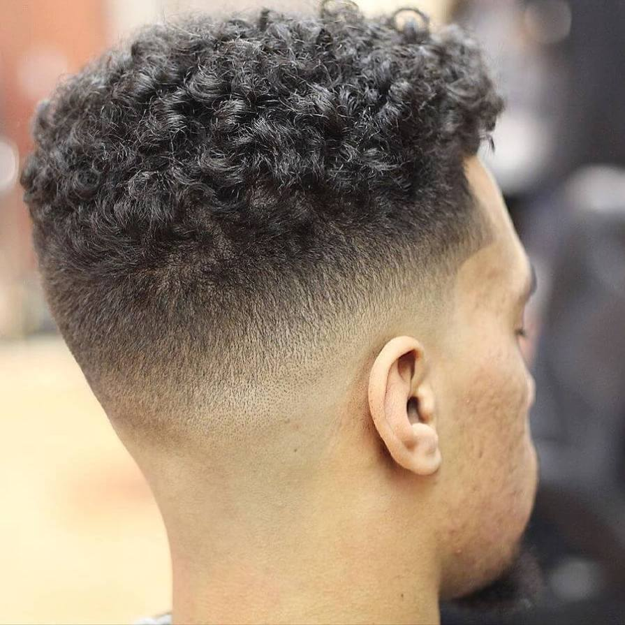 Medium Length Curls + Mid Skin Fade