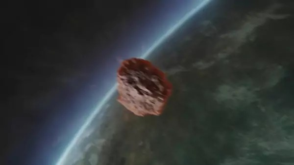An asteroid in space approaching the atmosphere of a planet.