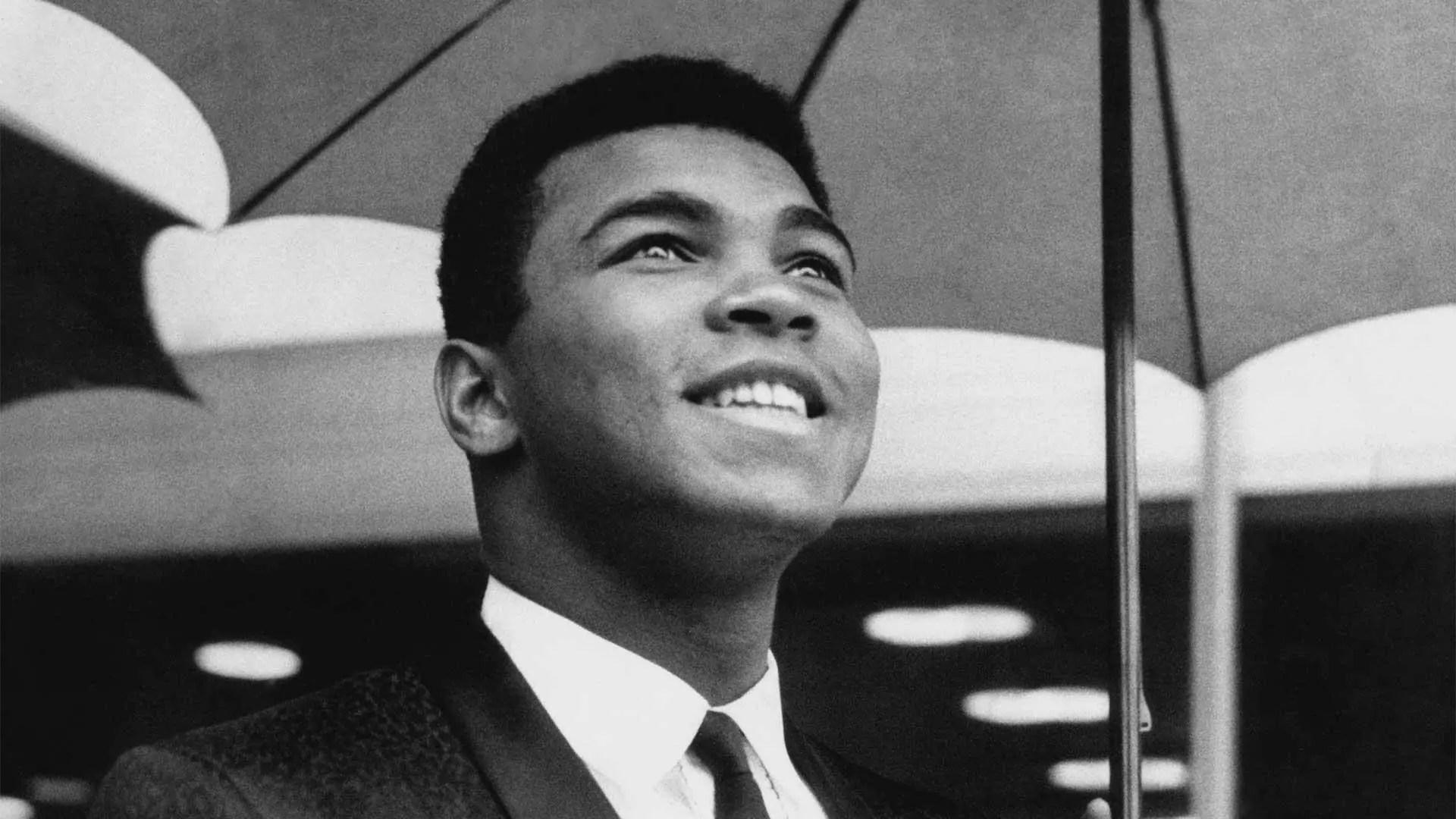 Muhammad Ali Smiling under an umbrella