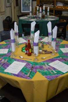 Tables on Friday night with placemats by Roxanne Beard.