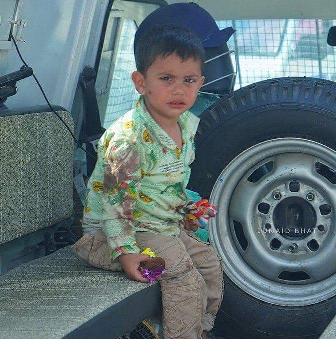 Three year old Kashmiri child in the police van after Sopore Encounter