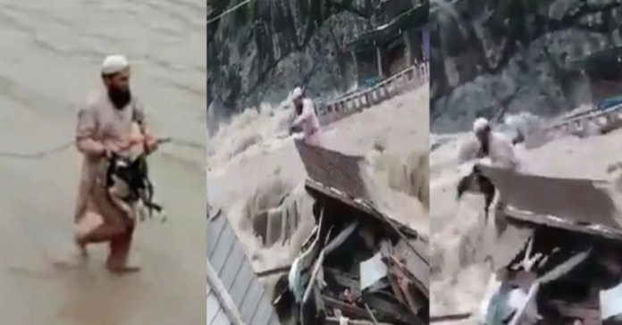Man saves a stray dog from massive flood